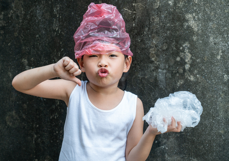 Cute little girl is posing with plastic bags. Concept for stop using plastic bag.