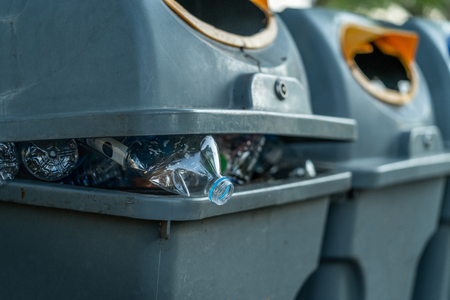 Close up plastic bottle waste in garbage bin.