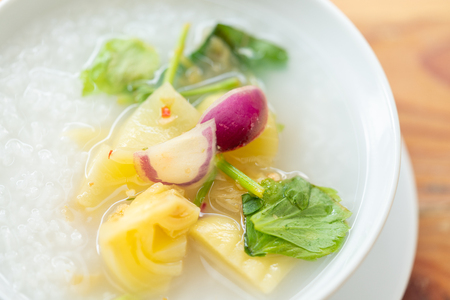 Close up delicious pickled cabbage mixed with purple onion, chilli and celery over rice soup.