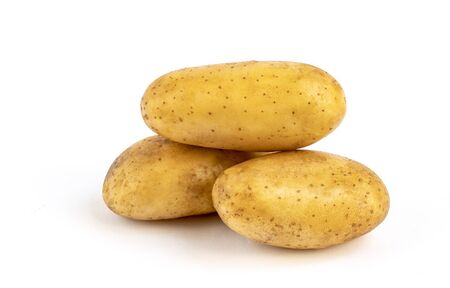 Close up raw potatoes on white background, stack of fresh potatoes.