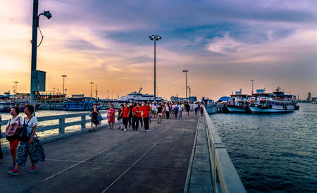 Pattaya, Thailand: May 19, 2019 Atmosphere in evening at Balihai Peninsula. Many tourists from many nations have returned from Koh Lan by boat. Late evening with impressive colorful skies in Pattaya