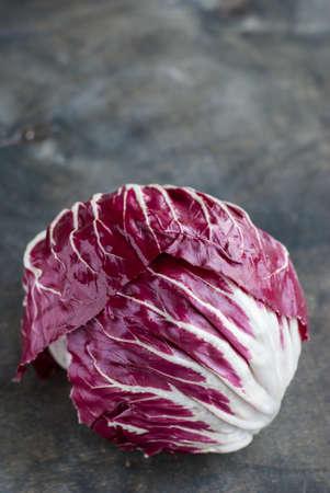 radicchio: Radicchio red salad on dark wooden background