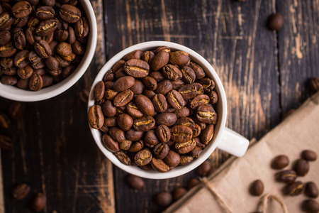 Roasted coffee beans in a cups photo