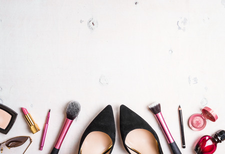 blogger: Feminine cosmetic background. Overhead of essentials of a modern woman. Cosmetic objects frame