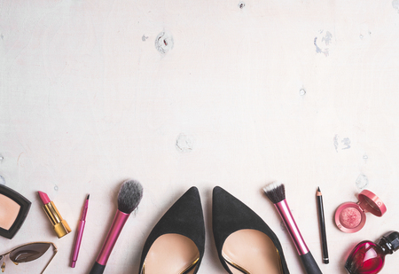 feminine: Feminine cosmetic background. Overhead of essentials of a modern woman. Cosmetic objects frame. Instagram filter style