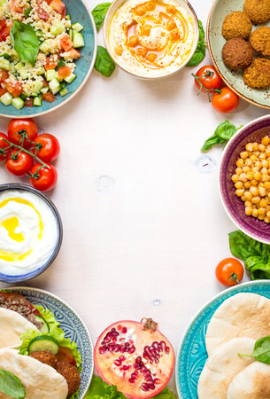 doner: Middle eastern traditional dishes on a white background. Doner kebap, vegetarian pita, bowl with hummus, falafel, tabbouleh bulgur salad, boiled chickpea, olive oil dip, pomegranate. Space for text