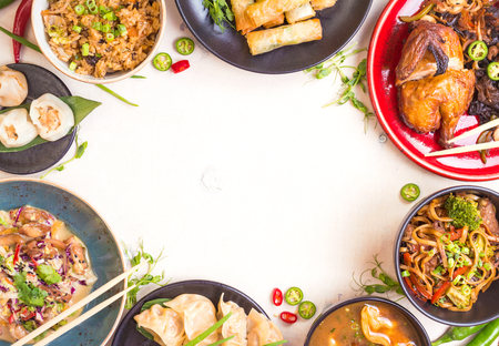 Chinese food white background. Chinese noodles, fried rice, dumplings, peking duck, dim sum, spring rolls. Famous Chinese cuisine dishes set. Space for text. Top view. Chinese restaurant concept Foto de archivo