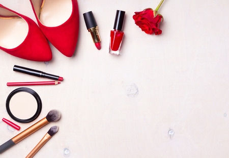 Beauty cosmetic white background. Makeup essentials. Shoes, red lipstick, powder, brushes set. Cosmetic products. Top view. Feminine or fashion background. Cosmetics. Beauty products. Modern woman 스톡 콘텐츠