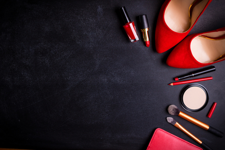 Beauty cosmetic black background. Makeup essentials. Shoes, red lipstick, powder, brushes set. Cosmetic products. Top view. Feminine or fashion background. Cosmetics. Beauty products. Modern woman Foto de archivo