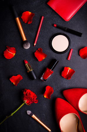 Beauty cosmetic black background. Makeup essentials. Shoes, red lipstick, powder, brushes set. Cosmetic products. Top view. Feminine or fashion background. Cosmetics. Beauty products. Modern woman Stock Photo