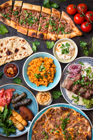 Traditional assorted turkish dishes. Turkish pizza, meat kebab, pita, bulgur, fried meatballs, hummus and turkish meze set. Middle eastern dinner. Food party. Turkish cuisine. Top view. Eastern food 스톡 콘텐츠