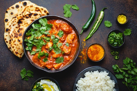 Traditional Indian dish Chicken tikka masala with spicy curry meat in bowl