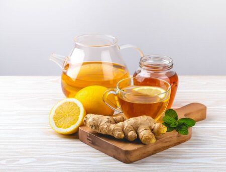 Ginger and lemon tea on white