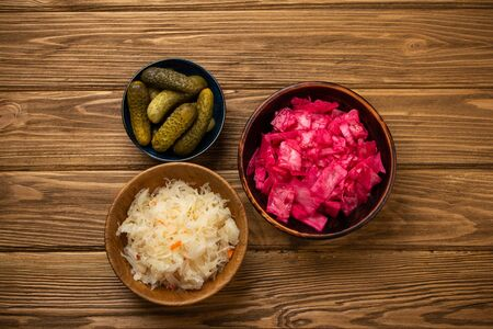 Assorted fermented vegetables on wooden table