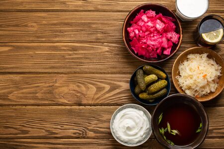 Assorted fermented foods on wooden table Фото со стока