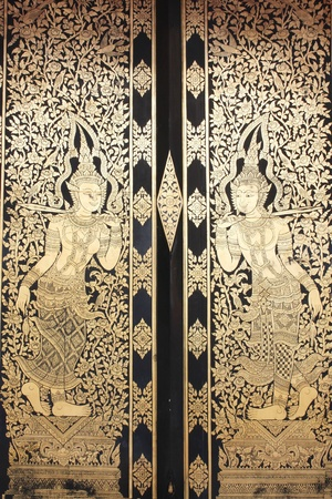 black wood texture: golden deity painting on the temple door