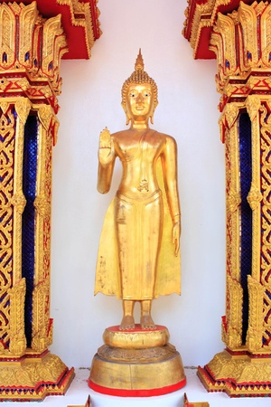 golden buddha image in front of the ordination hall Stock Photo - 13567695