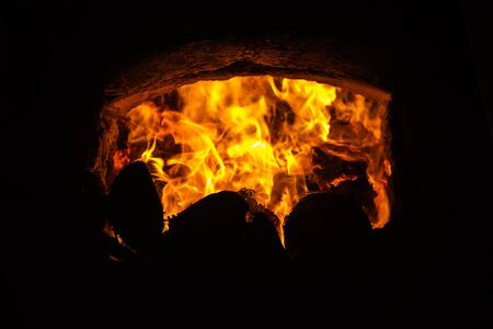 fire in the kiln burning with part of coconut