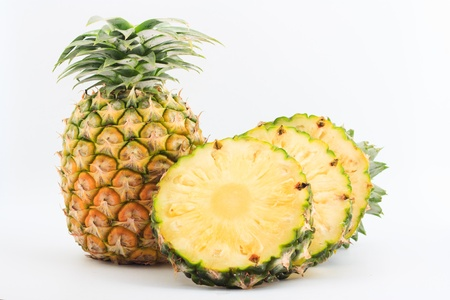 the sliced pineapple on white background photo