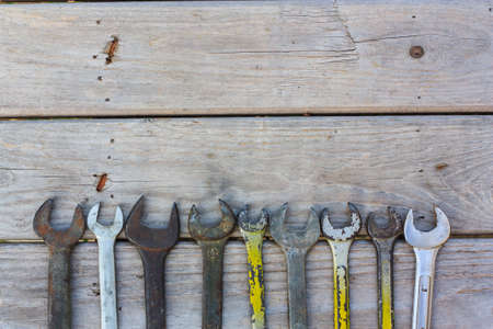 the old spanner on wood background photo