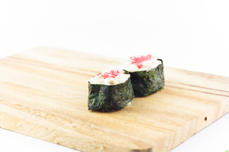 trencher: sushi in wooden plate on white background