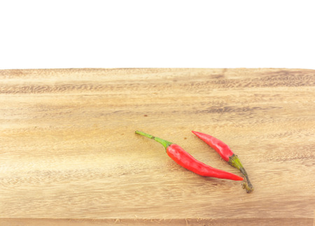 trencher: group of red chili on chopping block in white background