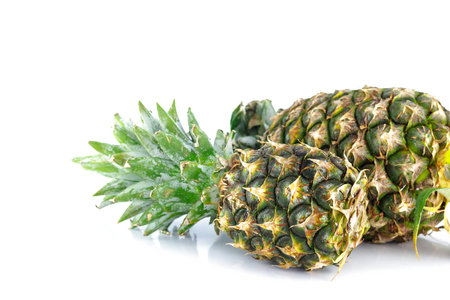 descriptive colors: ripe pineapple on white background Stock Photo