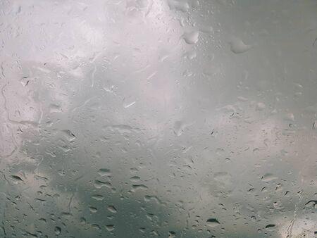 rain droplet on car window on drak background