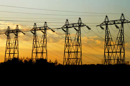 powe: High voltage towers power at sunset