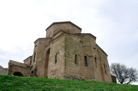 the view from below: The ancient monastery Jvari on the background of the spring sky, view from below