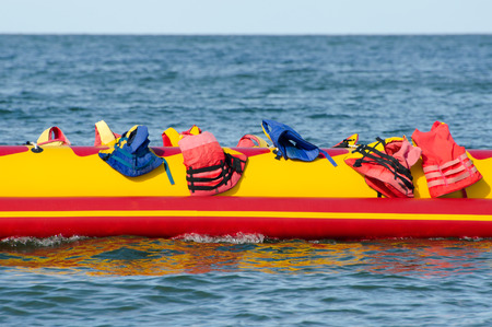 Empty water banana with jackets in the sea, water attraction Stock Photo