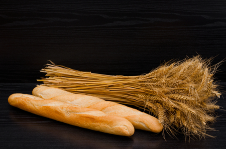 sheaf: Two white loaf and a sheaf on a black background Stock Photo