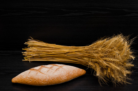 sheaf: Delicious rye bread and a sheaf on a black background