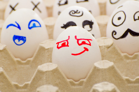 painted face: Painted eggs in tray, cunning, joyful, Hercule Poirot