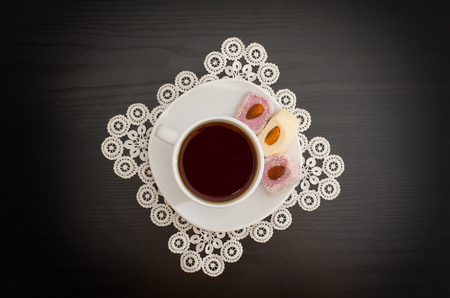 lace doily: Top view of a cup of coffee and Turkish delight with almonds on a saucer, lace doily Stock Photo