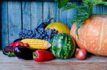 Autumn harvest: pumpkin, melon, watermelon, grapes, corn, eggplant, peppers, onions