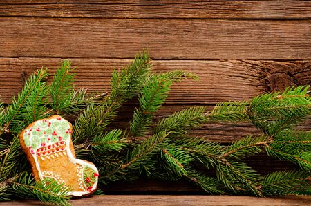 Gingerbread stocking and fir branch, place for text
