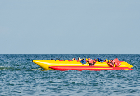 Empty water banana with life jackets at sea, water attraction