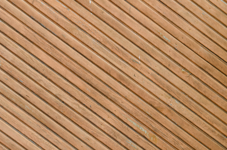 disposed: Diagonally disposed brown vintage planks. Vertically arranged. Texture. Background Stock Photo