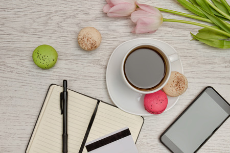 Planning of affairs. Mug of coffee with dessert, a notepad, a credit card and mobile phone. Business concept