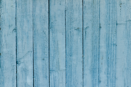 is green: Vertical wooden slats, old blue paint. Background
