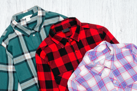 is green: Green, red and lavender plaid shirts. Fashionable concept