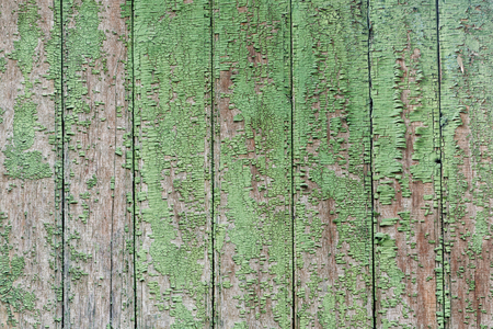 is green: Vertical wooden slats, old green cracked paint. Background