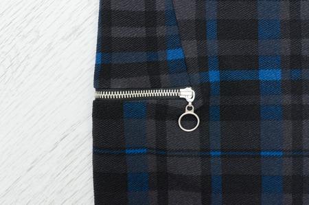 Blue checkered fabric with a zipper. Close-up Standard-Bild