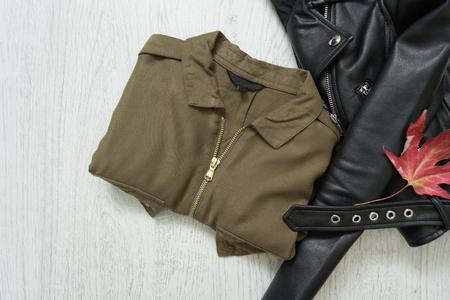 Khaki shirt and black jacket. Fashionable concept