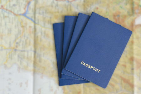 Four blue passport on a map. Travel Concept