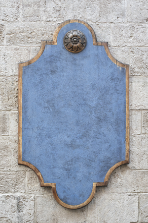 Blue figured plaque on a brick wall Stock Photo