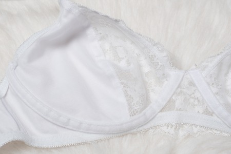 White lace bra, inner side. Flat lay. Fashion lingerie concept.
