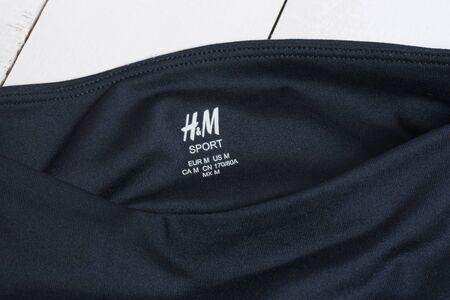 KHARKOV, UKRAINE - MARCH 04, 2019: Inscription H&M SPORTon navy blue clothes. Fashion concept. Close up