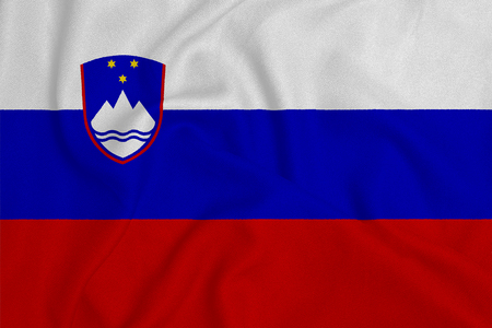 Flag of the Slovenia from the factory knitted fabric. Backgrounds and Textures.